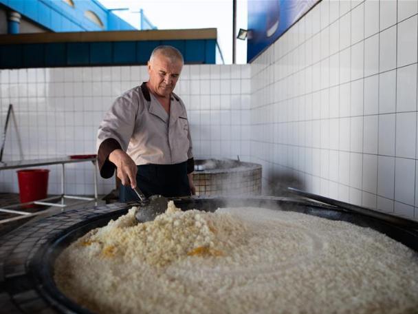People cook plov in Tashkent, Uzbekistan