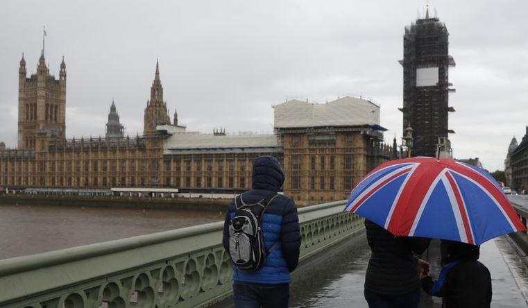 British lawmakers vote for Dec. 12 election after parliament vote