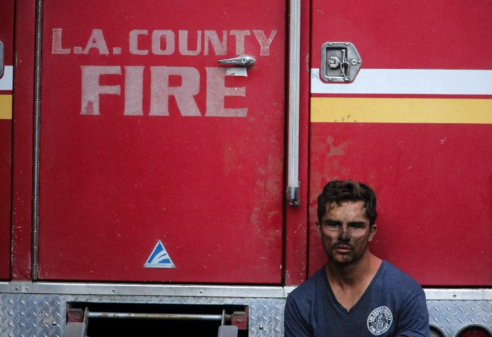 Crews battle California blazes before windstorms return