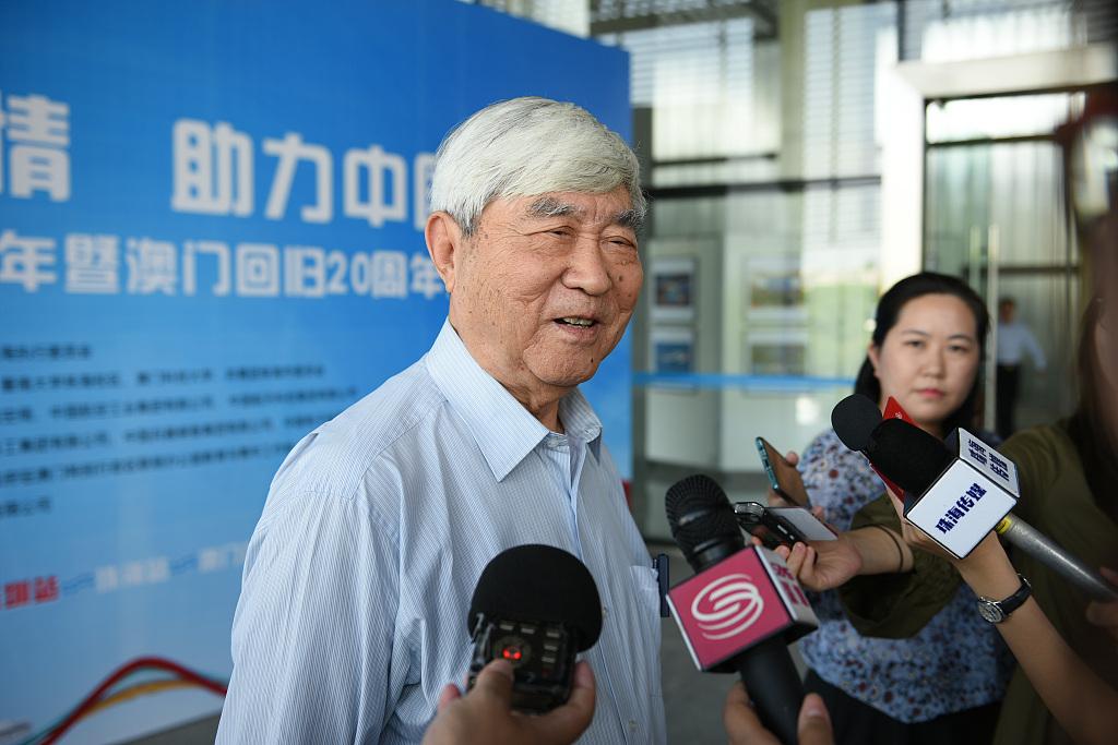 Chief spacecraft designer won IAC award amid Chinese delegation's absence