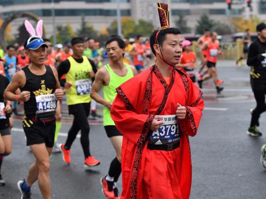 Runners compete in 2019 CFLD Beijing Marathon