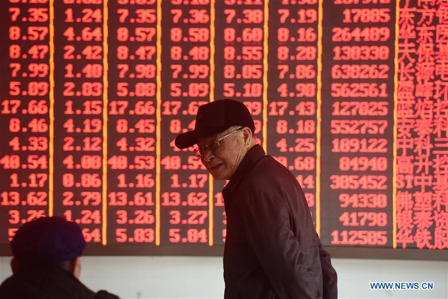Chinese shares open higher Monday