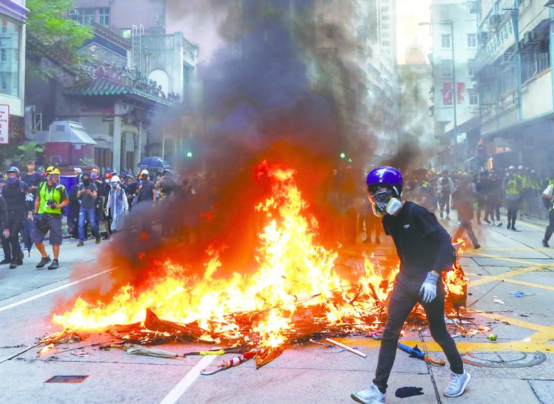 Hong Kong police condemn organized violence, vandalism by masked rioters