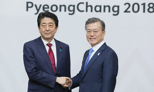 Moon, Abe back dialogue to fix issues