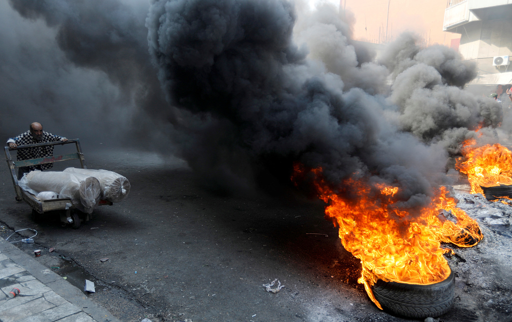 Iraq's PM urges protesters to stop, says unrest is hurting the economy