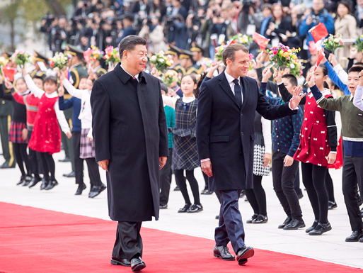 Xi holds talks with Macron in Beijing