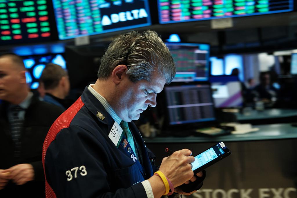 US stocks open slightly lower amid Fed official's speech