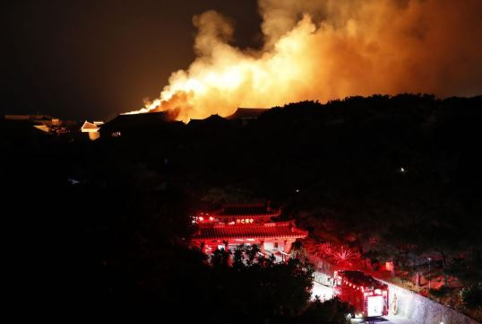 Japan's Abe vows all out measures to rebuild iconic Okinawa castle after devastating blaze