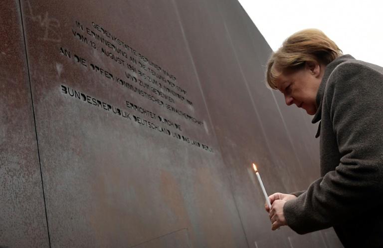 On Wall anniversary, Merkel urges Europe to defend freedom