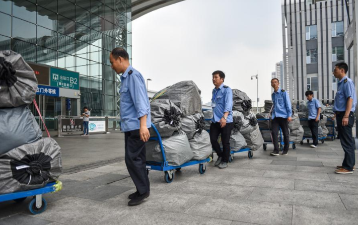 Courier giants brace for Double 11 with automated logistics