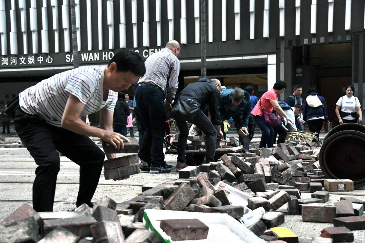 Volunteers clear the way for HK's recovery