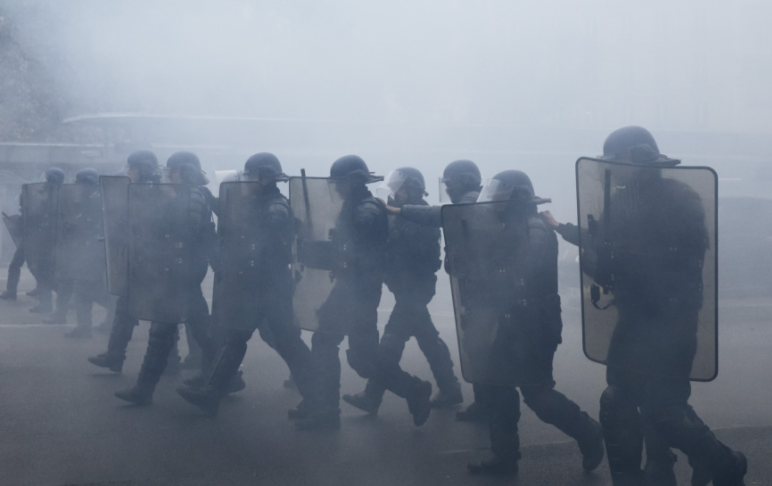 Paris police fire tear gas at protesters on 'Yellow Vest' anniversary