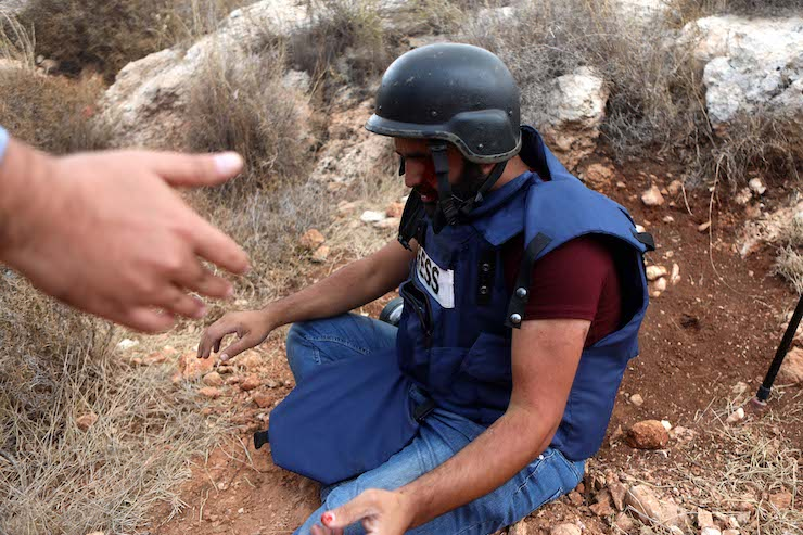 Palestinian journalists launch campaign for colleague injured by Israeli soldier
