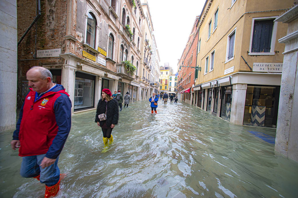 3rd record tide enters Venice as Italy hit with snow, rain