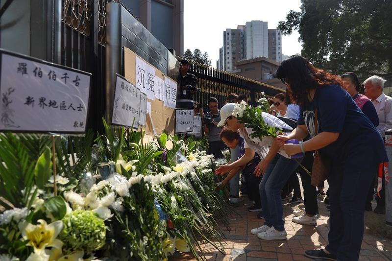 Remains of man hit by HK rioter's brick to be buried in mainland