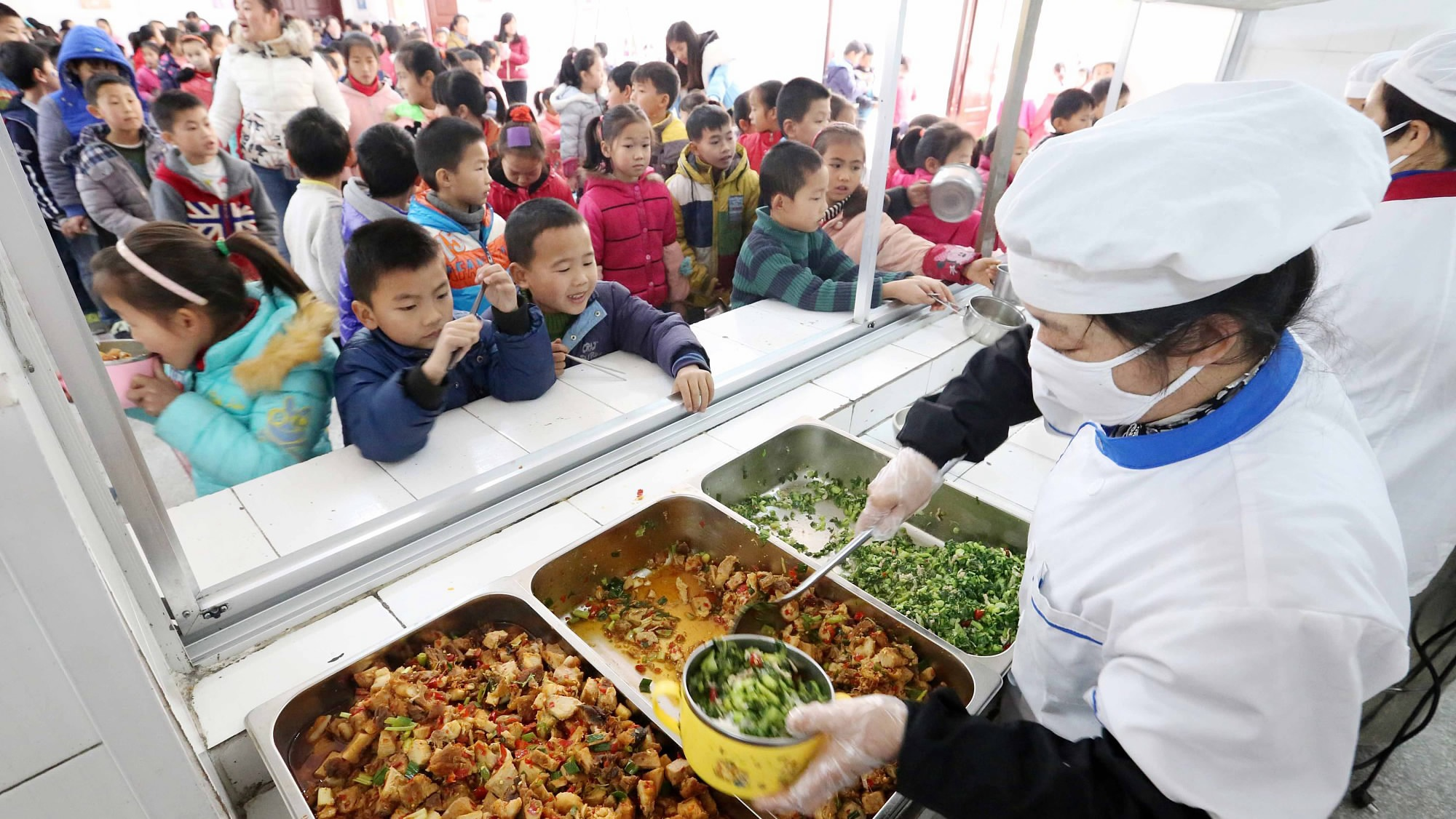 China vows to ensure food safety in schools, kindergartens