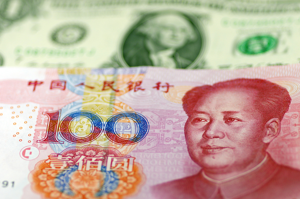 Chinese yuan weakens to 7.0349 against USD Wednesday