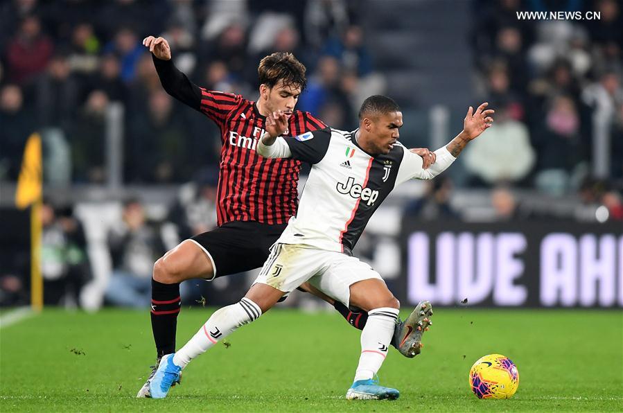Serie A soccer match: Juventus beats AC Milan 1-0