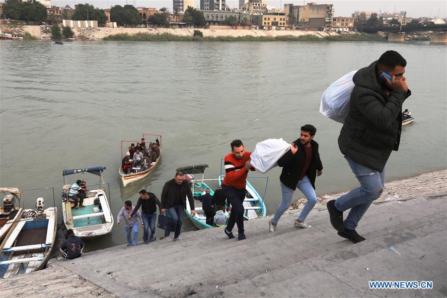 Iraqi citizens use boats to cross Tigris River in Baghdad, Iraq