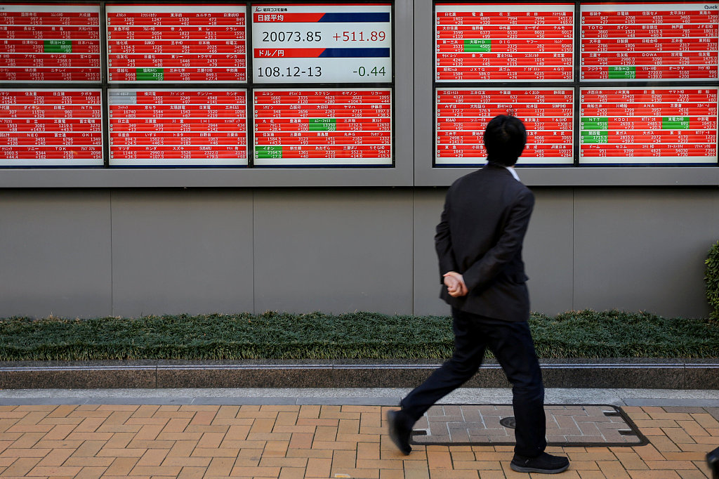 Tokyo stocks close lower on wariness about trade issues