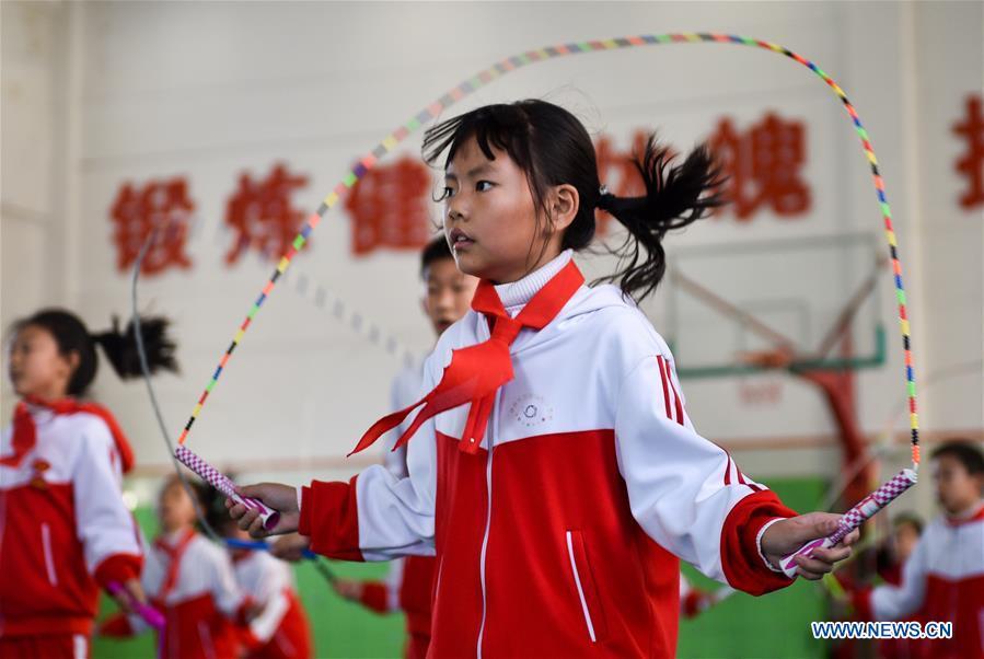 Pic story of rope jumping coach in Jilin, NE China's Jilin