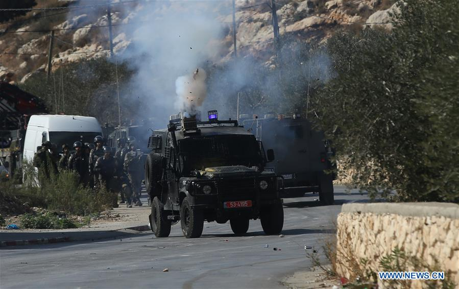 Palestinian protesters clash with Israeli troops near West Bank city of Nablus