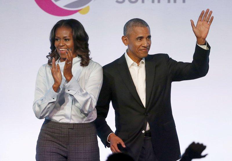 Obamas' publisher makes new pledge to education organization