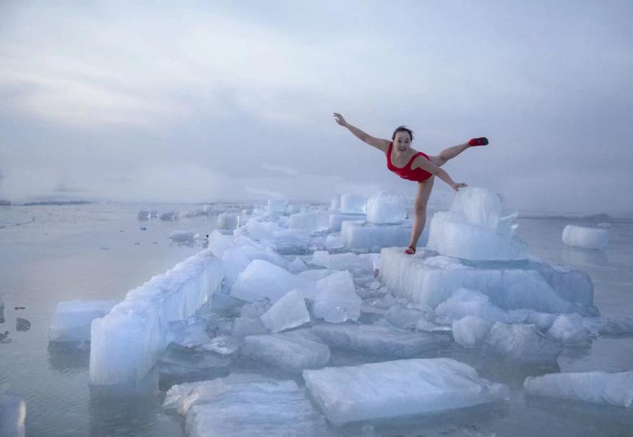 Ice, snow, ice pose no obstacle for winter river swimmer