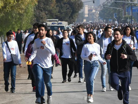 People take part in marathon dubbed 'I love You Syria' in colors in Damascus