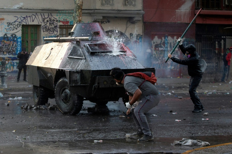 Protesters clash with police as Chile unrest enters 50th day