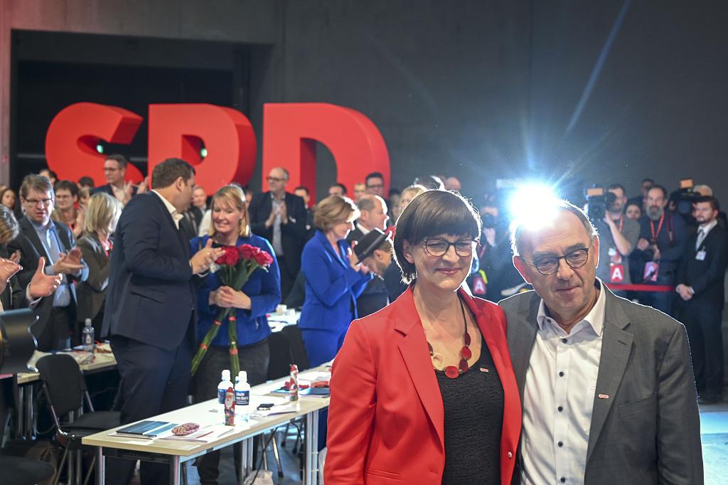Germany's SPD backs new leaders' demands to stay in Merkel coalition