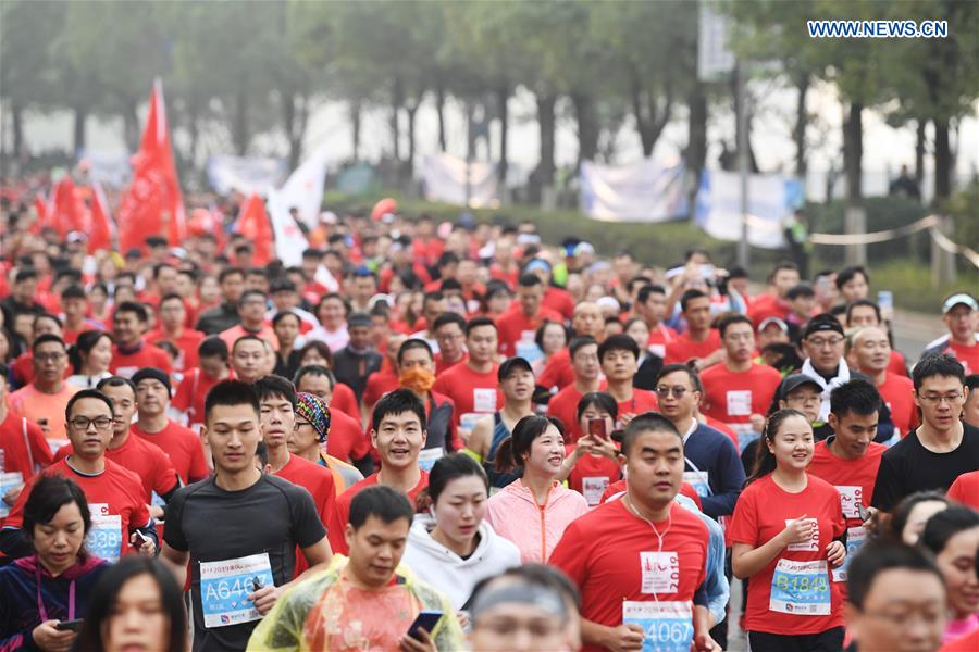 People participate in Int'l Half Marathon in SW China's Chongqing