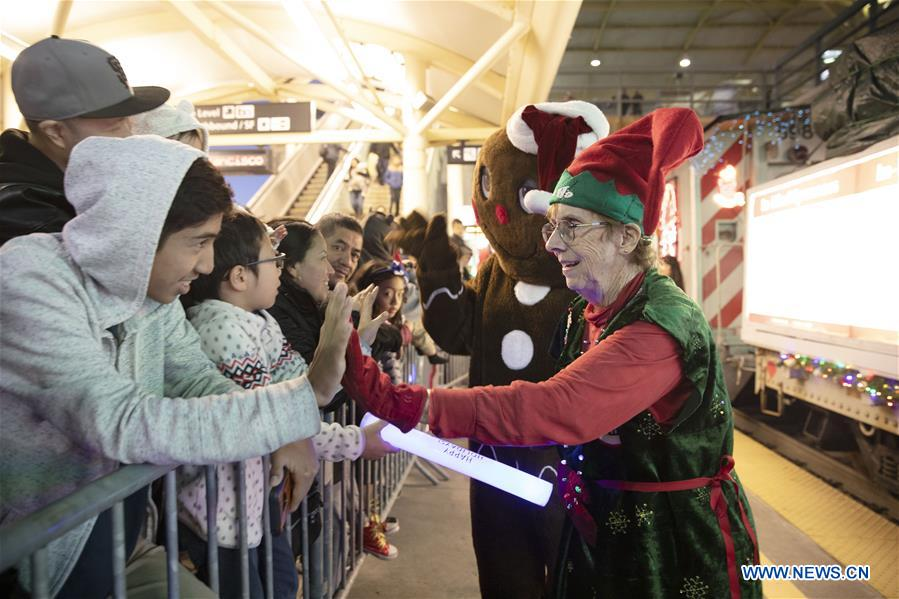 Christmas-themed Caltrain staff members greet residents in California