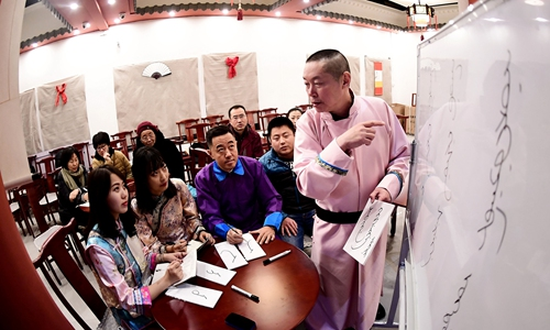Students enthusiastically seek to acquire one of China's most endangered languages