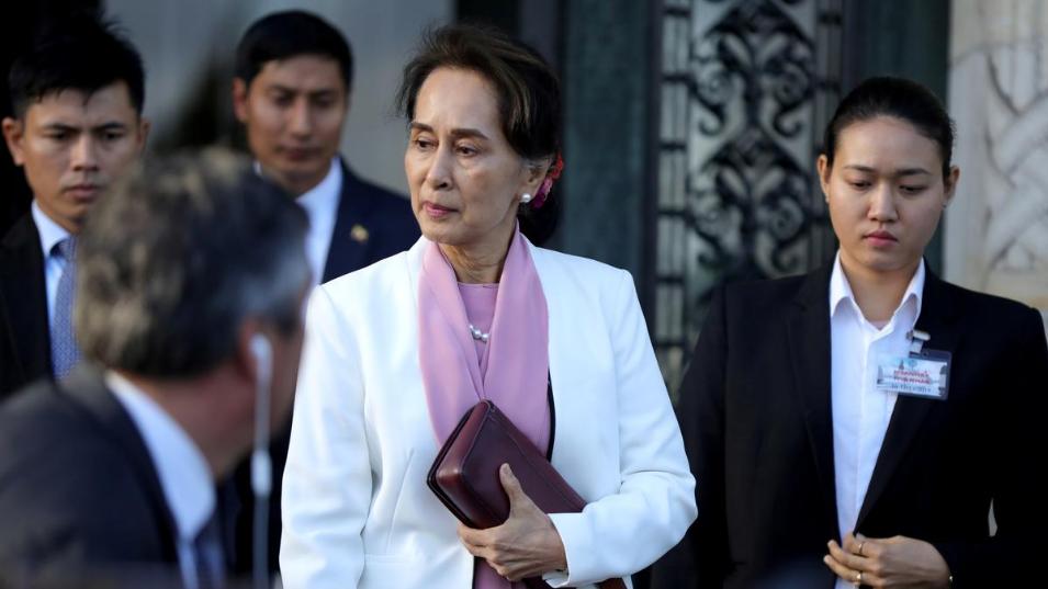 Myanmar's Suu Kyi denies genocide, warns reigniting crisis