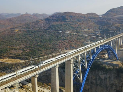 High-speed rail linking major cities in SW China's mountainous regions starts operations
