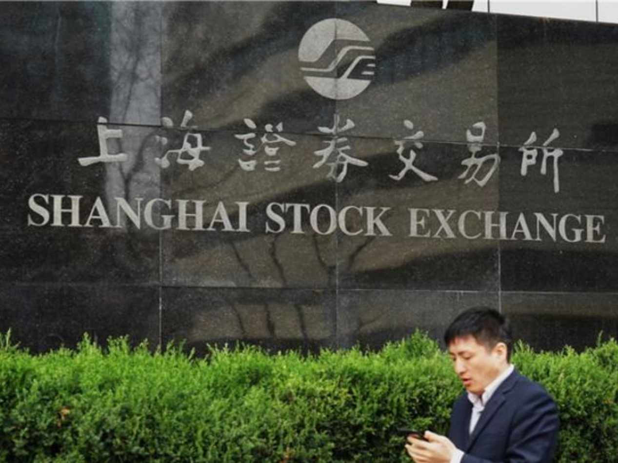 Chinese shares mixed at midday Wednesday