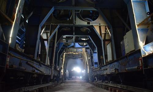 China-Laos railway's longest tunnel holed