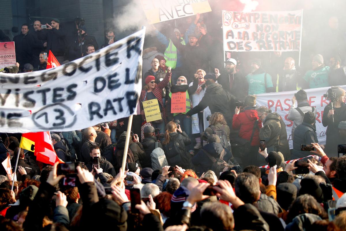 France's Macron pledges to push through pension reform