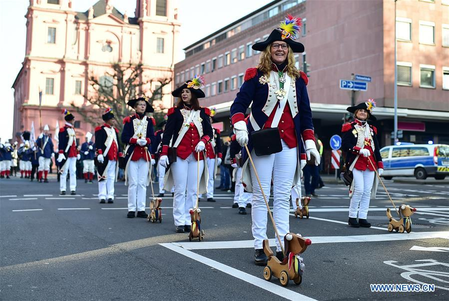 People participate in New Year's parade in Mainz, Germany