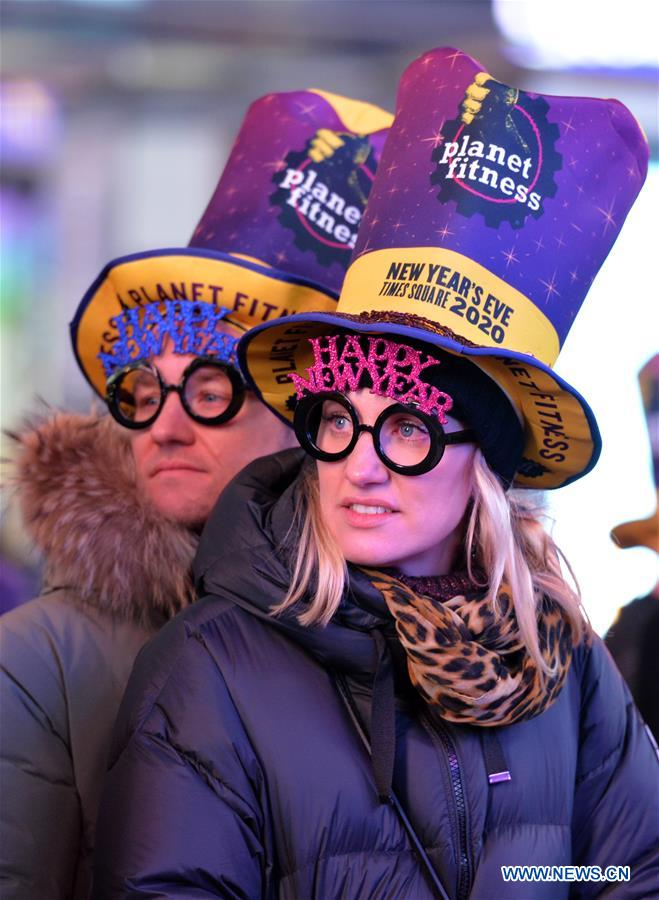 People participate in New Year celebration on Times Square in New York