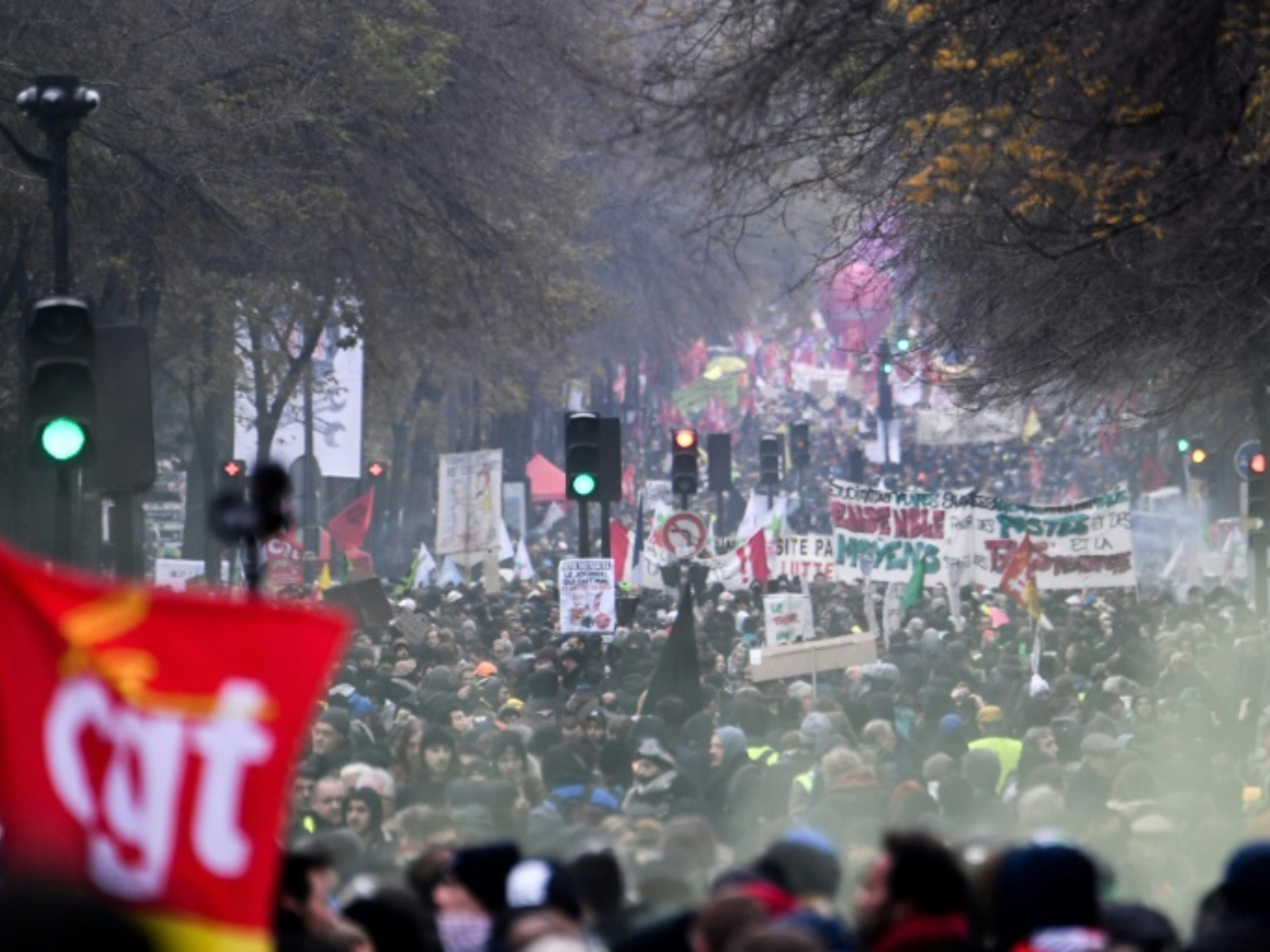 French unions vow no surrender in month-long strike