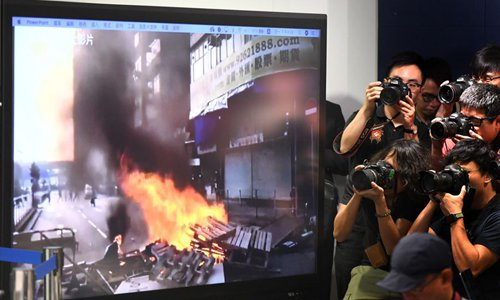 HK police arrest five for informing rioters of police deployments