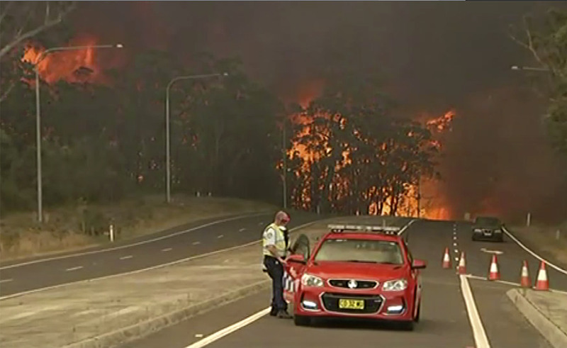 Australia orders mass evacuation of fire-ravaged towns before heatwave