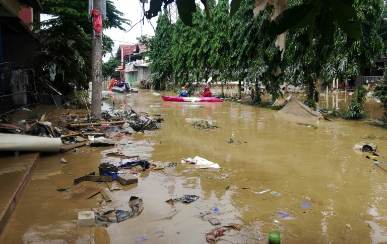 Indonesia flood rescuers hunt for missing after 43 killed