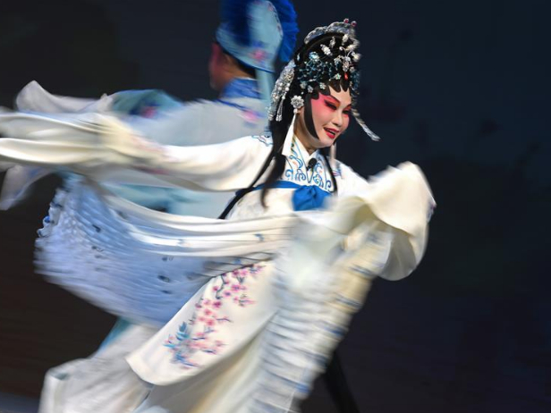 Chinese opera singers perform Cantonese opera in Singapore