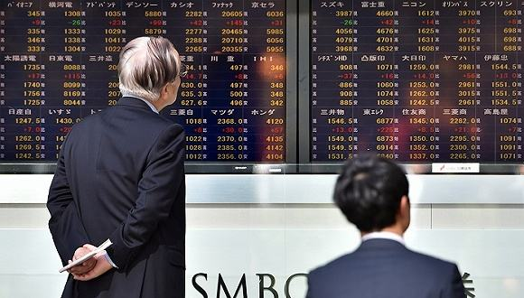 Tokyo stocks close sharply lower as yen spikes on Middle East tensions