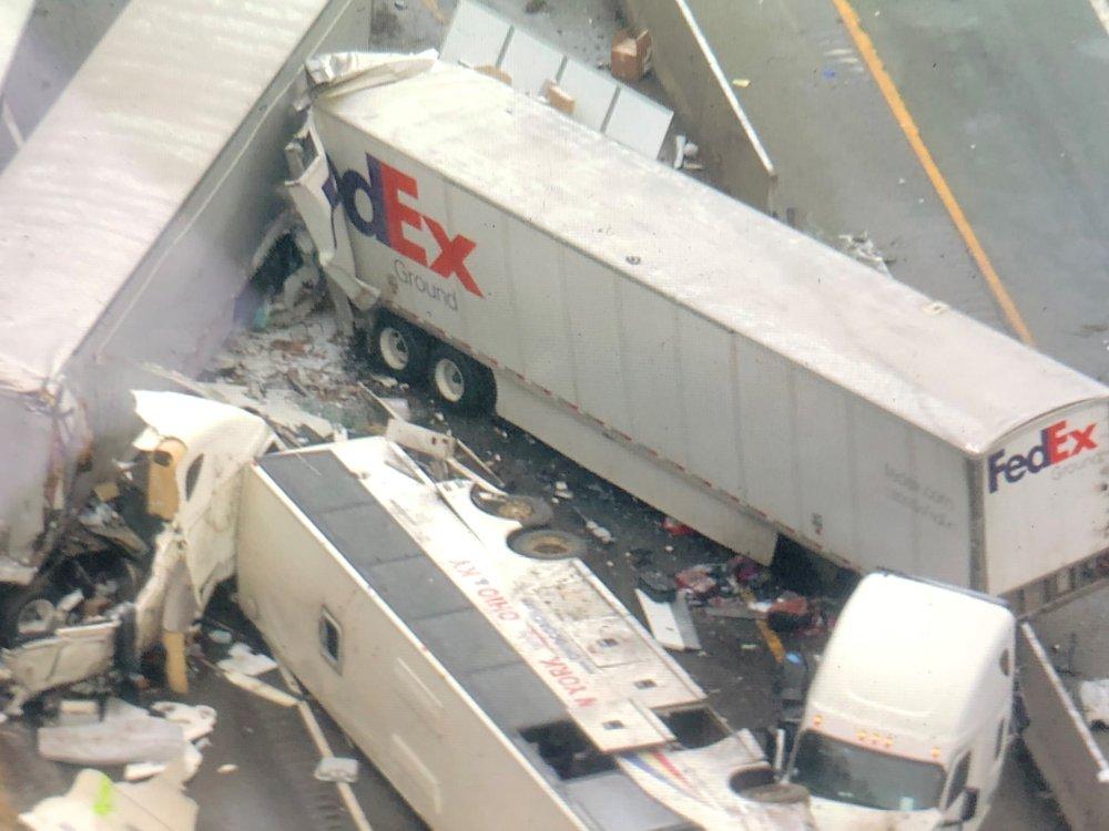 Investigators say bus passed truck before wreck killing 5