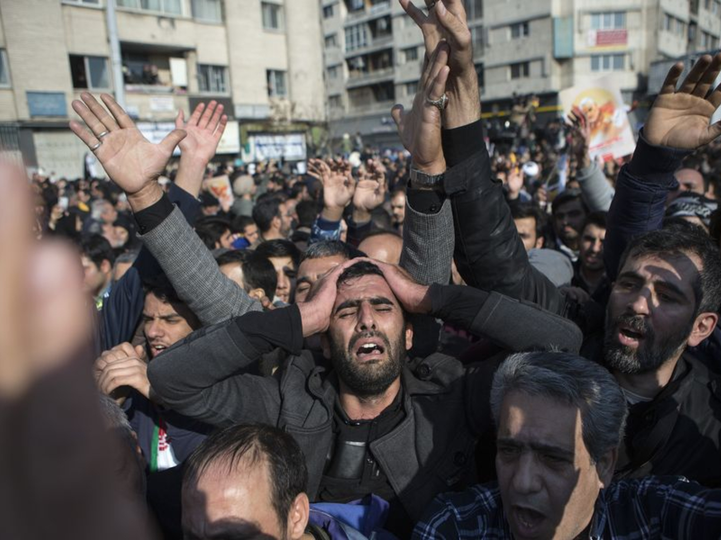 Iranians mourn assassinated senior general at funeral