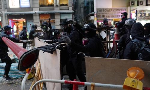 Hong Kong 'frontline' riots in retreat